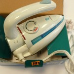 Dual voltage travel iron folding handle
